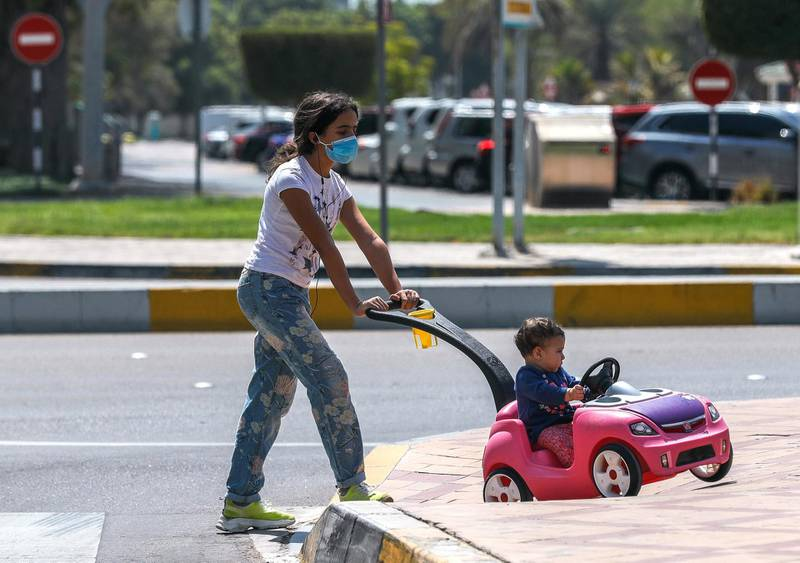 Abu Dhabi, United Arab Emirates, September 15, 2020.  A girl takes a young boy on a stroll along Al Bateen street on a humid Tuesday.Victor Besa /The NationalSection:  NA/Stock ImagesReporter: