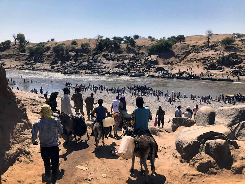 The Hamadayet border crossing, where refugees from Ethiopia cross the river into Sudan. New arrivals take whatever belongings they can carry with them, some have their livestock's and  others left with nothing.