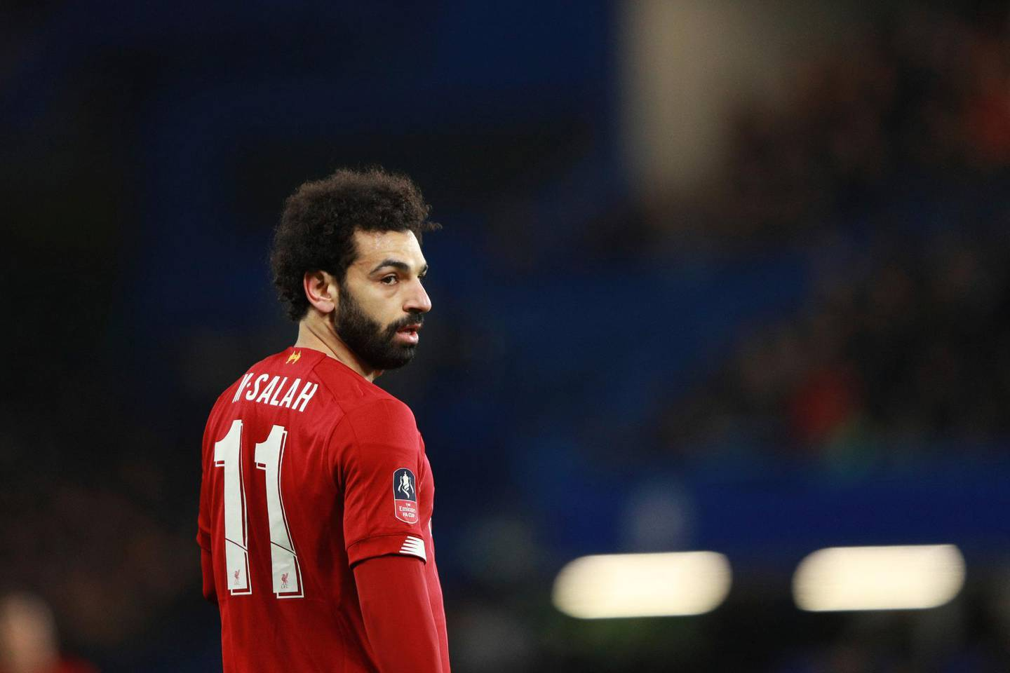 Liverpool's Mohamed Salah reacts during the English FA Cup fifth round soccer match between Chelsea and Liverpool at Stamford Bridge stadium in London Tuesday, March 3, 2020. (AP Photo/Ian Walton)