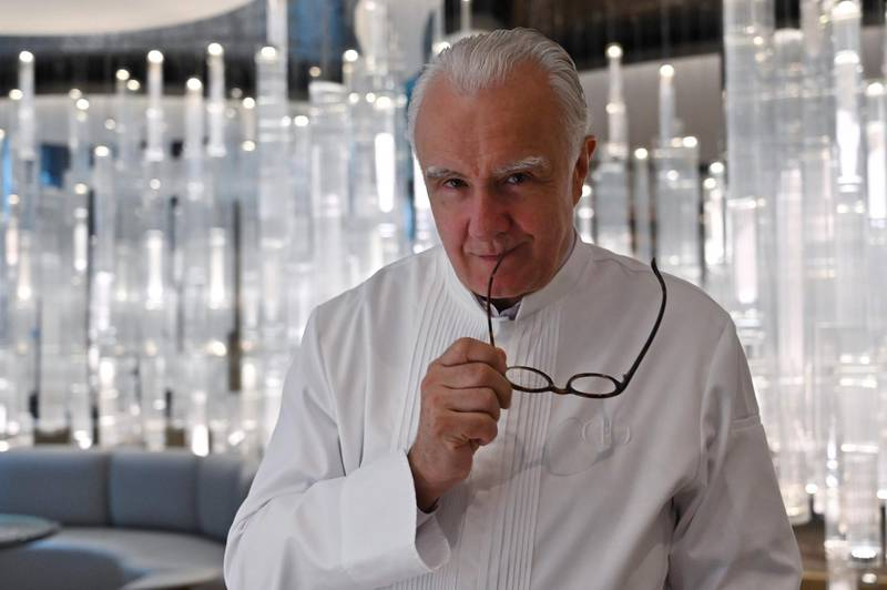 """(FILES) In this file photograph taken on June 18, 2019, French chef Alain Ducasse poses during an interview with AFP at his restaurant Alain Ducasse at The Morpheus Hotel in Macau. French superstar chef Alain Ducasse insists that it is safer to eat in restaurants than at home during the coronavirus epidemic. With restaurants shuttered by lockdowns across the world, Ducasse claimed that it was far riskier to shop and cook at home. """"It's better to eat in a restaurant that takes all the precautions than at home where you have to go to your little local supermarket where people are bumping into each other, touching the fruit and not everybody is wearing masks,"""" he told AFP.  -   / AFP / Hector RETAMAL"""