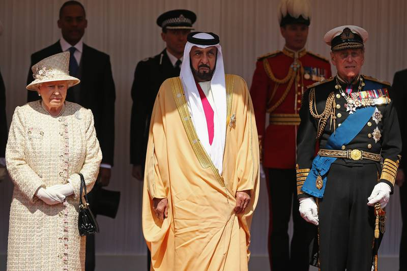 Queen Elizabeth II with the President of the United Arab Emirates, Sheikh Khalifa bin Zayed Al Nahyan,centre, and Prince Phillip on the Royal Dais in Windsor, as he begins a State Visit to the UK Tuesday April 30, 2013. (AP Photo/Dan Kitwood, Pool) *** Local Caption ***  Britain Royals UAE.JPEG-074f3.jpg