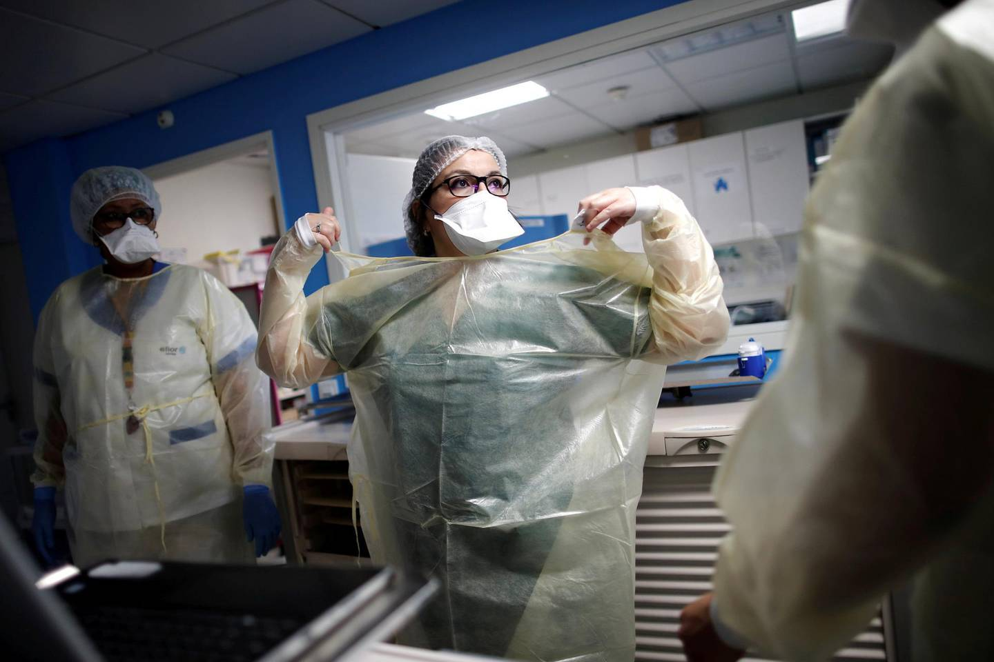 Doctor Widad Abdi works in the Intensive Care Unit (ICU) where patients suffering from the coronavirus disease (COVID-19) are treated at the Clinique de l'Estree - ELSAN private hospital in Stains, near Paris, France, March 18, 2021.  REUTERS/Benoit Tessier