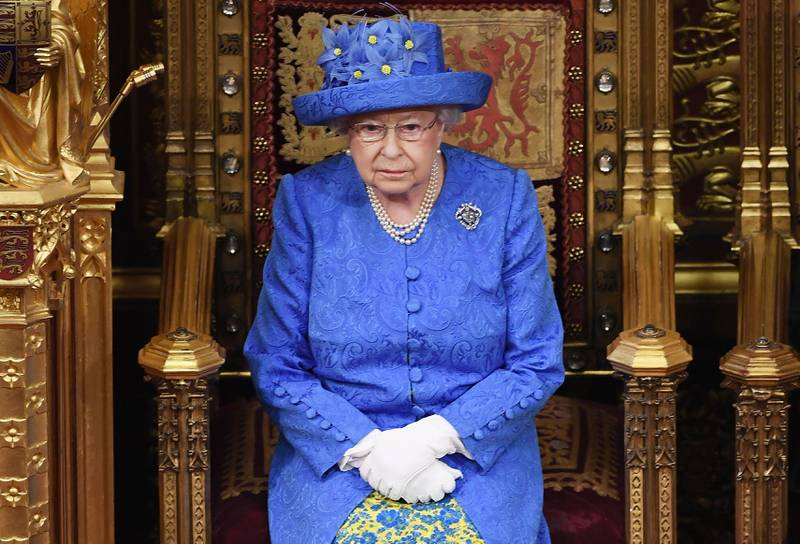 """(FILES) In this file photo taken on June 21, 2017 Britain's Queen Elizabeth II attends the State Opening of Parliament in the House of Lords at the Houses of Parliament in London on June 21, 2017.  Queen Elizabeth II has emphasised the need for Britons to come together to """"seek out the common ground"""", in what has been viewed as an appeal to overcome divisions over Brexit. Speaking to members of the Women's Institute (WI) near her Sandringham estate in eastern England, the 92-year-old said people should never lose sight of the bigger picture. / AFP / POOL / Carl Court"""