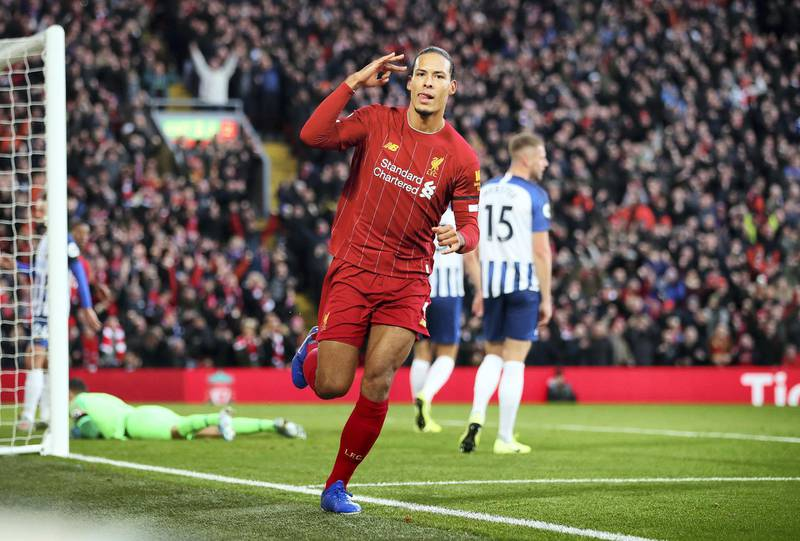 LIVERPOOL, ENGLAND - NOVEMBER 30:  Virgil van Dijk of Liverpool celebrates after scoring his teams first goal during the Premier League match between Liverpool FC and Brighton & Hove Albion at Anfield on November 30, 2019 in Liverpool, United Kingdom. (Photo by Clive Brunskill/Getty Images)
