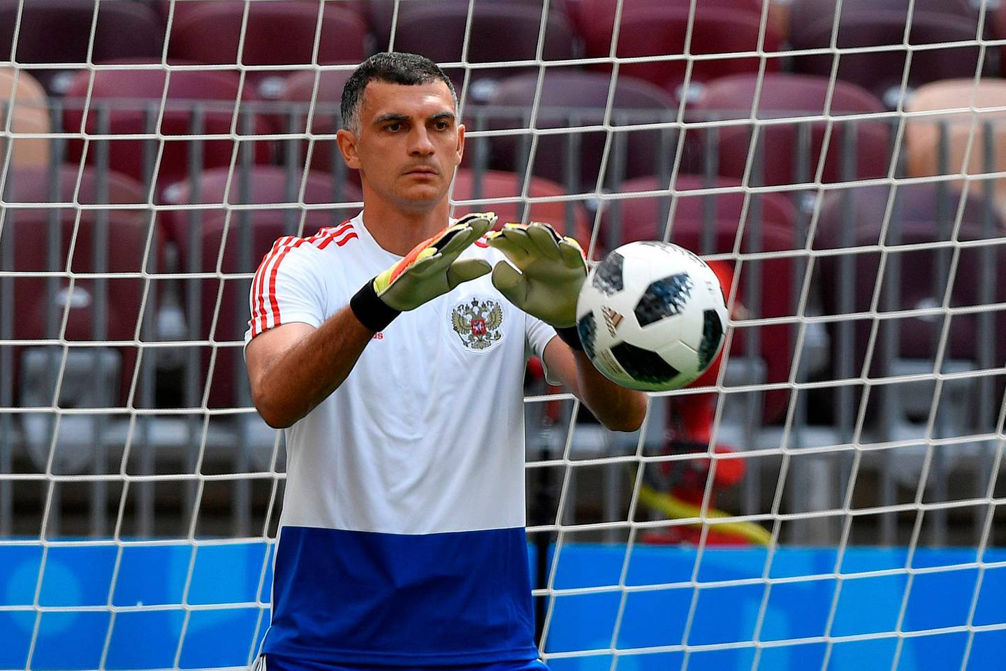 Russia's goalkeeper Vladimir Gabulov takes part in a training session at the Luzhniki Stadium in Moscow on June 13, 2018 ahead of the Russia 2018 World Cup opening football match between Russia and Saudi Arabia. / AFP / Alexander NEMENOV