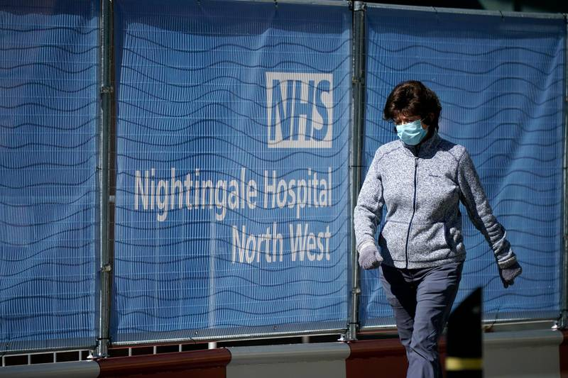 MANCHESTER, ENGLAND - APRIL 14: A woman walks past the completed NHS Nightingale Hospital North West at Manchester Central on April 14, 2020 in Manchester, United Kingdom. The Coronavirus (COVID-19) pandemic has spread to many countries across the world, claiming over 115,000 lives and infecting over 1. 9 million people. (Photo by Christopher Furlong/Getty Images)