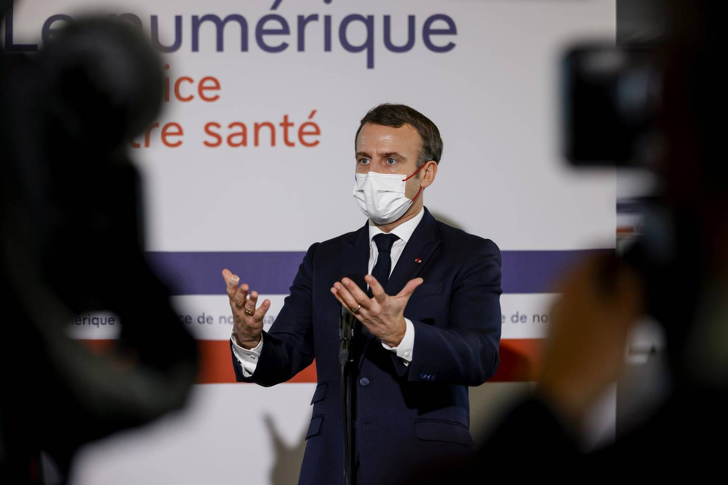 French President Emmanuel Macron, wearing a face mask, gestures as he gives a speech about health research during a visit of the Necker Hospital in Paris, France December 4, 2020. Thomas Samson/Pool via REUTERS