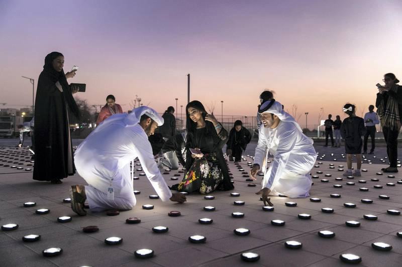 ABU DHABI, UNITED ARAB EMIRATES - JANUARY 9, 2019. Volunteers set up a 20mx20m light installation, comprised of 2,000 solar lanterns, arranged to reveal the Zayed Sustainability Prize logo.Following a month-long, five-country, transcontinental journey, the Zayed Sustainability Prizes Guiding Light campaign arrived to Abu Dhabi today. (Photo by Reem Mohammed/The National)Reporter: Section:  NA