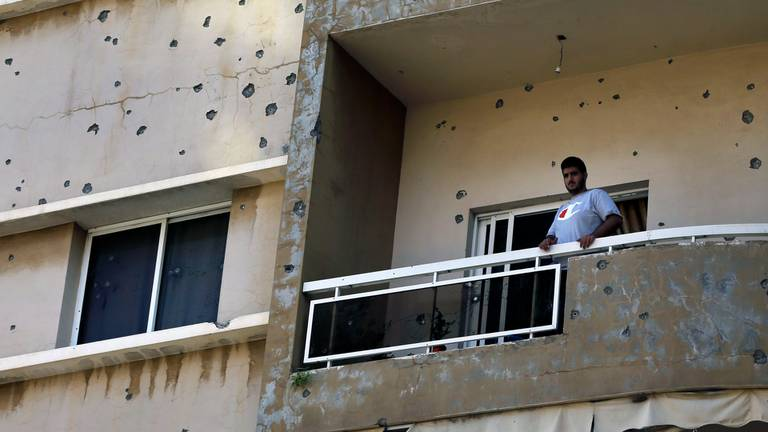 An image that illustrates this article Residents assess the damage after deadly Beirut clashes