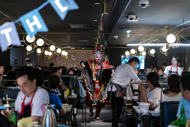 A Chinese face-changing artist performs at a Haidilao hotpot restaurant, operated by Sichuan Haidilao Catering Co., in Hong Kong, China, on Saturday, Sep 22, 2018.