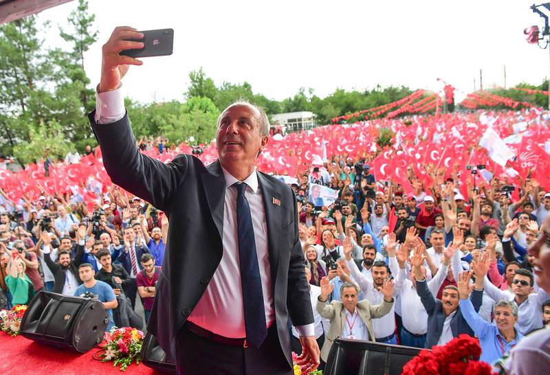 Muharrem Ince, presidential candidate of Turkey's main opposition Republican People's Party, takes a pictures as he addresses an election rally in Diyarbakir, Turkey, Monday, June 11, 2018. Ince is seen as a strong contender to end Turkey's President Recep Tayyip Erdogan's rule in presidential elections on June 24.(CHP Press Service via AP, Pool)