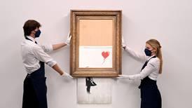 Half-shredded Banksy artwork sells for $25m