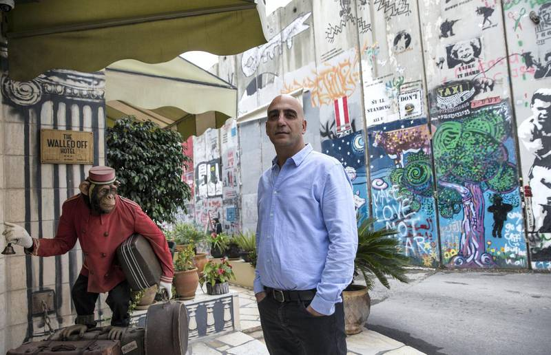 Wisam Salsa, the Walled-Off Hotel's Palestinian co-founder and manager as he stands outside the entrance .Salsa says, ÒItÕs given a massive boost to the Palestinian tourism industry.Ó (Photo by Heidi Levine for The National).