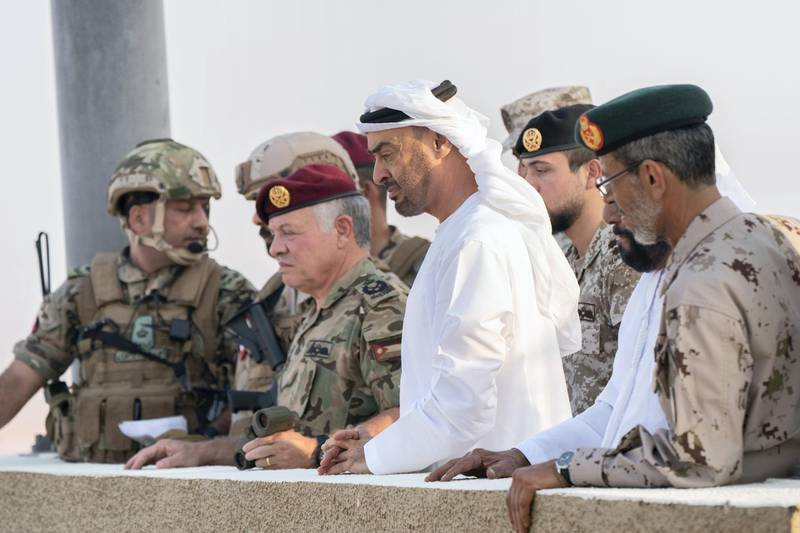 AL DHAFRA REGION, ABU DHABI, UNITED ARAB EMIRATES - June 26, 2019: (R-L) HE Lt General Hamad Thani Al Romaithi, Chief of Staff UAE Armed Forces, HH Sheikh Mohamed bin Zayed Al Nahyan, Crown Prince of Abu Dhabi and Deputy Supreme Commander of the UAE Armed Forces and HM King Abdullah II, King of Jordan, attend the UAE and Jordan joint military drill, Titled 'Bonds of Strength', at Al Hamra Camp.  ( Rashed Al Mansoori / Ministry of Presidential Affairs ) ---