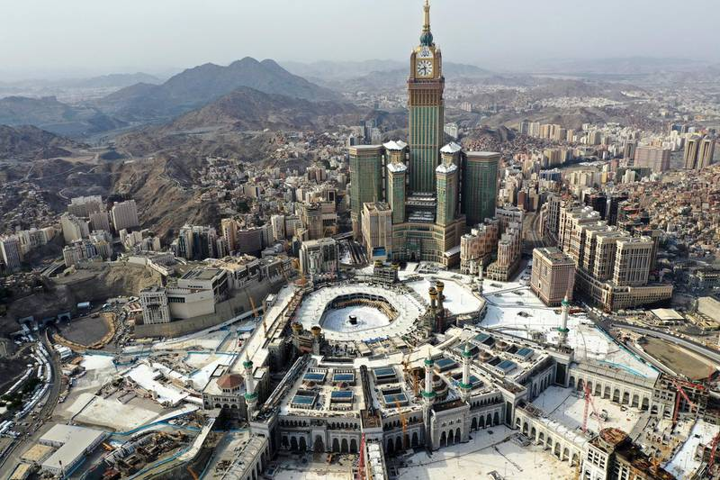 An aerial view taken on July 31, 2020 shows pilgrims circumambulating (Tawaf Al-Ifada) around the Kaaba, the holiest shrine in the Grand mosque in the holy Saudi  city of Mecca. (Photo by STR / AFP)