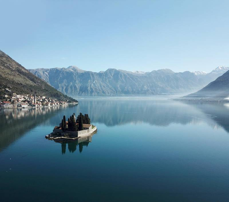Our Lady of the Rock and city of Perast in Boka Kotorska