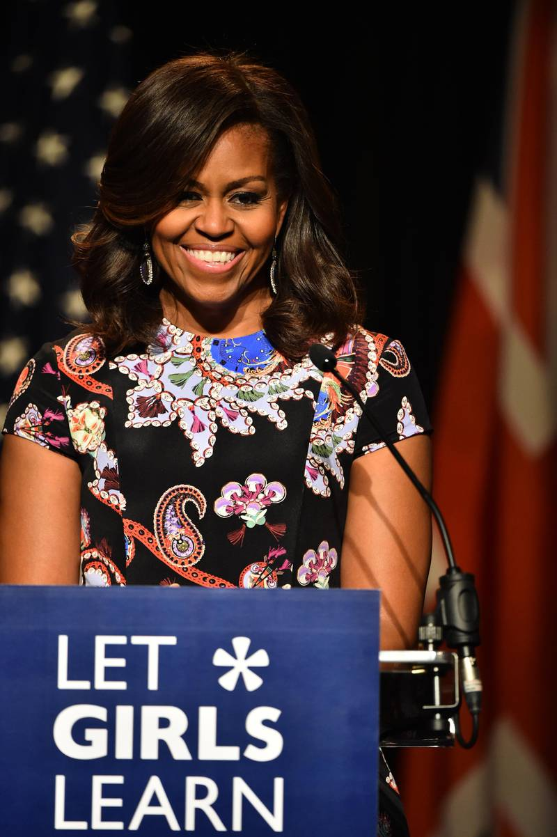 LONDON, ENGLAND - JUNE 16:  US First Lady Michelle Obama smiles as she speaks to students as part of the 'Let Girls Learn Initiative' at the Mulberry School for Girls on June 16, 2015 in London, England. The US First Lady is travelling with her daughters, Malia and Sasha and her mother, Mrs. Marian Robinson, to continue a global tour promoting her 'Let Girls Learn Initiative'. The event at the school was to discuss how the UK and USA are working together to expand girl's education around the world.  (Photo by Jeff J Mitchell/Getty Images)