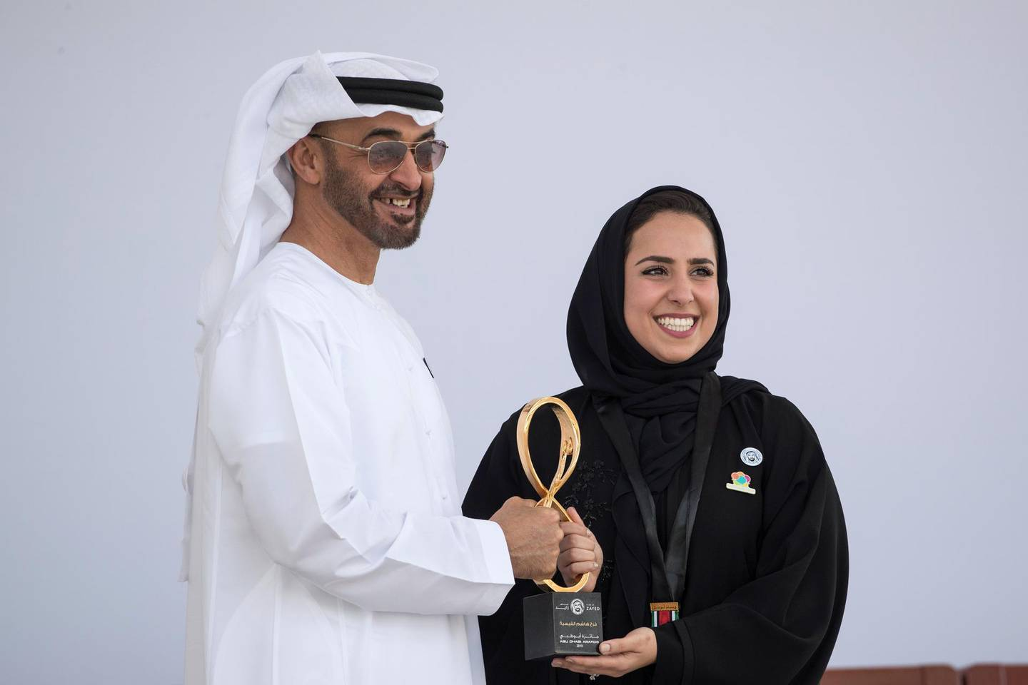 ABU DHABI, UNITED ARAB EMIRATES -  March 12, 2018: HH Sheikh Mohamed bin Zayed Al Nahyan, Crown Prince of Abu Dhabi and Deputy Supreme Commander of the UAE Armed Forces (L), presents an Abu Dhabi Award to Farah Hashem Al Qaissieh (R), during the awards ceremony at the Sea Palace. ( Ryan Carter for the Crown Prince Court - Abu Dhabi ) ---