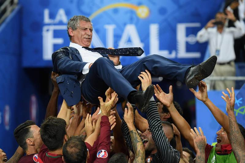 PARIS, FRANCE - JULY 10:  Fernando Santos manager of Portugal is thrown into the air by his players after his side win 1-0 against France during the UEFA EURO 2016 Final match between Portugal and France at Stade de France on July 10, 2016 in Paris, France.  (Photo by Matthias Hangst/Getty Images)