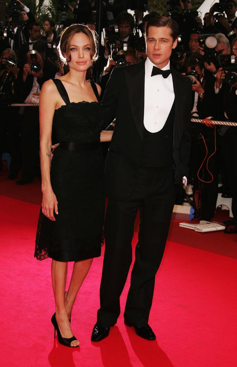 """CANNES, FRANCE - MAY 21:  Actors Brad Pitt and Angelina Jolie attend the premiere for the film """"A Mighty Heart"""" at the Palais des Festivals during the 60th International Cannes Film Festival on May 21, 2007 in Cannes, France.  (Photo by Peter Kramer/Getty Images)"""