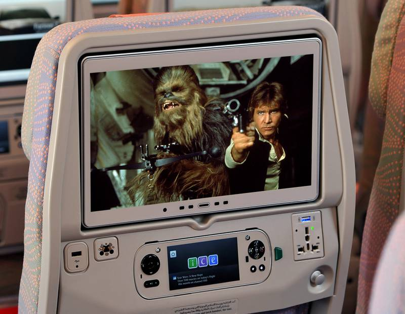 """dUBAI, U.A.E., 13 December 2015 –Emirates customers will be able to enjoy the first six Star Wars movies in one epic journey from January. For the first time, these films will be available on Emirates' award-winning inflight entertainment system, ice. Passengers will be able to immerse themselves in a dedicated Star Wars section of ice Digital Widescreen. This will include: Star Wars: A New Hope (1977); Star Wars: The Empire Strikes Back (1980); Star Wars: Return of the Jedi (1983); Star Wars: The Phantom Menace (1999); Star Wars: Attack of the Clones (2002) and Star Wars: Revenge of the Sith (2005). """"We always aim to offer our passengers the best content on board and are delighted to bring the first six Star Wars movies to our screens. With a total run time of over 13 hours, customers could watch all six films at one go on some of our long haul flights. It will allow Star Wars enthusiasts to re-watch the classic films and gives others a chance to see why these movies have such a huge fan base worldwide,"""" said Patrick Brannelly, Emirates' Divisional Vice President – Customer Experience. The Star Wars feature is in addition to over 2,000 channels of on-demand entertainment available on ice Digital Widescreen including over 500 movies in January 2016. The seventh and soon to be released installment, Star Wars: The Force Awakens will be available on Emirates in early 2016. (Courtesy Emirates Airlines) *** Local Caption ***  Star-Wars-on-ice.jpg"""
