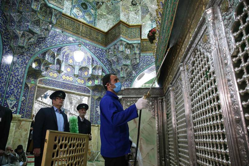 TOPSHOT - Iranian sanitary workers disinfect Qom's Masumeh shrine on February 25, 2020 to prevent the spread of the coronavirus which reached Iran, where there were concerns the situation might be worse than officially acknowledged.  The deaths from the disease -- officially known as COVID-19 -- in the Islamic republic were the first in the Middle East and the country's toll with so far a dozen people officially reported dead, is now the highest outside mainland China, the epidemic's epicentre. / AFP / FARS NEWS AGENCY / MEHDI MARIZAD