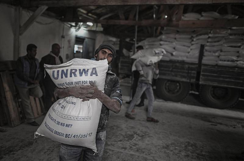 epa06988519 (FILE) A Palestinian refugee carries a sack with flour at the United Nation food distribution center in al Shateaa refugee camp in the northern Gaza city, 15 January 2018 (reissued 31 August 2018).  According to media reports on 31 August 2018, the United States has ended all funding to the United Nations Relief and Works Agency for Palestine Refugees in the Near East (UNRWA). 'The administration has carefully reviewed the issue and determined that the United States will not make additional contributions to UNRWA' according to a statement by the US State Department.  EPA/MOHAMMED SABER