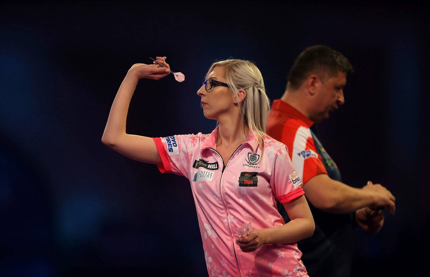 Fallon Sherrock and Mensur Suljovic in action during day nine of the William Hill World Championships at Alexandra Palace, London, Saturday Dec. 21, 2019. (Steven Paston/PA via AP)