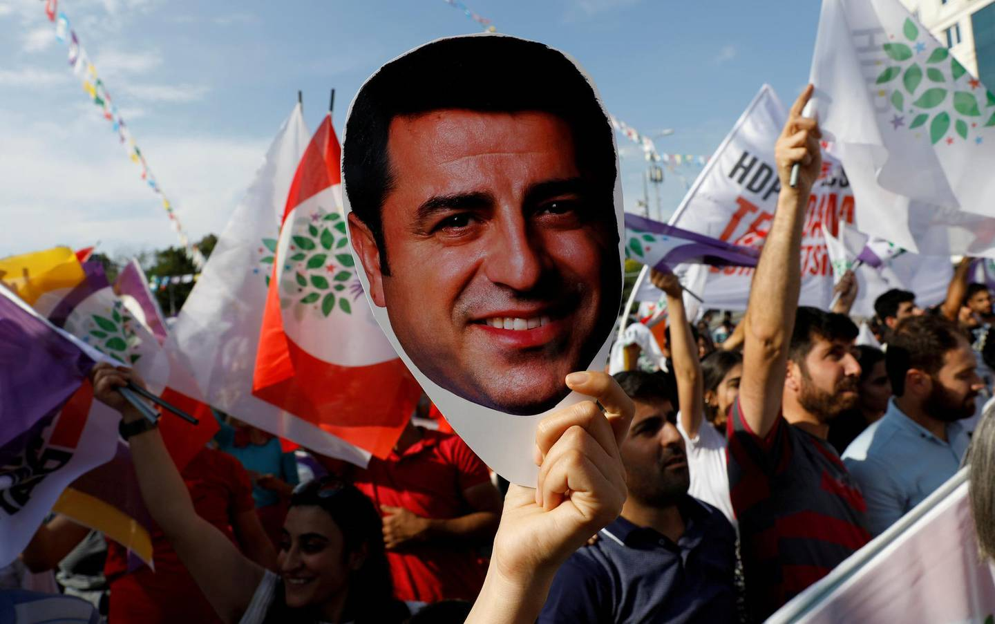 FILE PHOTO: A supporter of the pro-Kurdish Peoples' Democratic Party (HDP) holds a mask of their jailed former leader and presidential candidate Selahattin Demirtas during a rally in Ankara, Turkey, June 19, 2018. REUTERS/Umit Bektas/File Photo