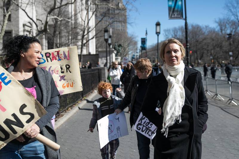 Cynthia Nixon, actress and 2018 New York gubernatorial Democratic candidate, right, walks on Central Park West ahead of the March For Our Lives in New York, U.S., on March 24, 2018. Thousands of high school students and other gun-control advocates gathered in Washington and across the U.S. Saturday to demand tougher firearms restrictions from an older generation that's delivered little change after years of mass shootings. Photographer: Jeenah Moon/Bloomberg