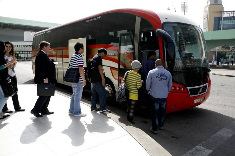 Abu Dhabi, UAE, 30th Jan. 2013: Travelers board the bus, that makes hourly trips from Abu Dhabi to Dubai and back, from the Abu Dhabi bus station, Airport Road, Abu Dhabi, 30th Jan. 2013 . Srijita Chattopadhyay / The National