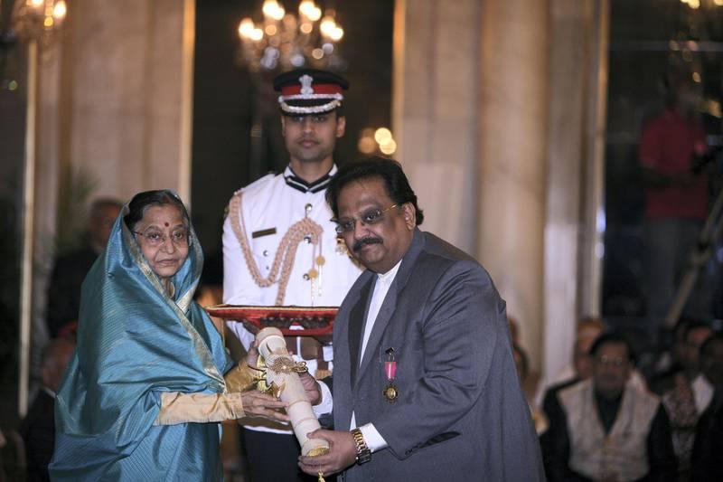 NEW DELHI, INDIA - MARCH 24: President Pratibha Patil presents Padma Bhushan to singer SP Balasubrahmanyam during Padma Awards 2011 ceremony at the Rashtrapati Bhavan in New Delhi on Thursday. (Photo by Shekhar Yadav/The India Today Group via Getty Images)