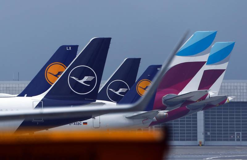 Tail fins of Deutsche Lufthansa AG and Eurowings passenger aircraft on the tarmac at Munich Airport in Munich, Germany, on Thursday, Nov. 12, 2020. Lufthansa rose yesterday on optimism a Covid-19vaccine will soon be available to enable easing of travel restrictions. Photographer: Michaela Handrek-Rehle/Bloomberg