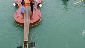 Watch a string quartet perform on a giant floating violin in Venice