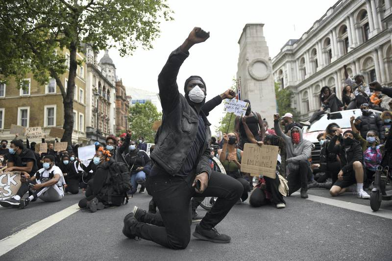 LONDON, ENGLAND - JUNE 03: Protesters kneel on the ground during a Black Lives Matter demonstration on Whitehall on June 3, 2020 in London, United Kingdom. The death of an African-American man, George Floyd, while in the custody of Minneapolis police has sparked protests across the United States, as well as demonstrations of solidarity in many countries around the world. (Photo by Chris J Ratcliffe/Getty Images)