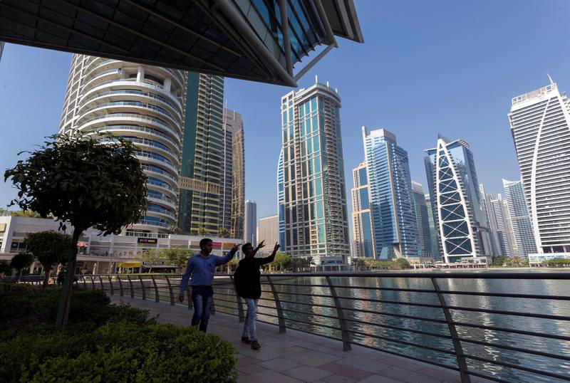 Dubai, United Arab Emirates - October 18th, 2017: Standalone. People at Jumeirah Lake Towers point at some of the skyscrapers. Wednesday, October 18th, 2017 at JLT, Dubai. Chris Whiteoak / The National