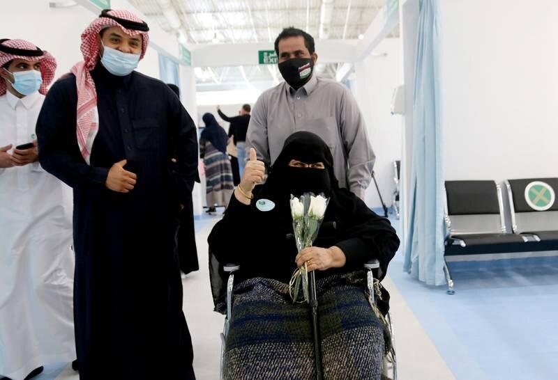 A Saudi woman gestures after she received the first dose of a coronavirus disease (COVID-19) vaccine, in Riyadh, Saudi Arabia December 17, 2020. REUTERS/Ahmed Yosri