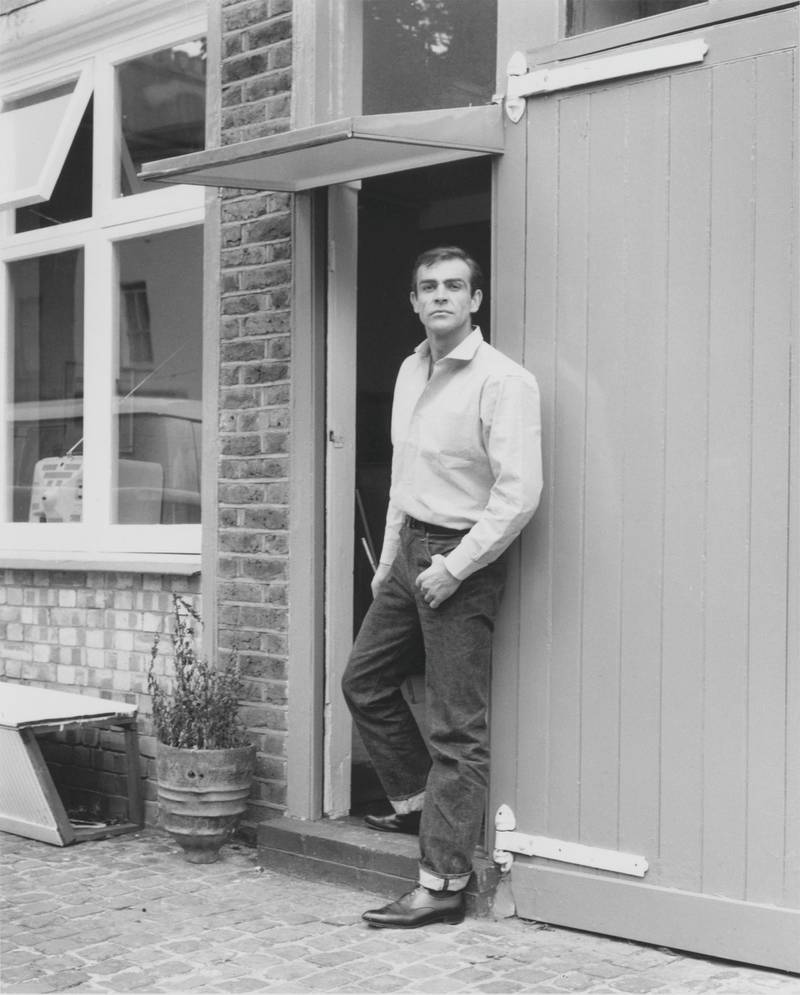 Scottish actor Sean Connery, the new face of James Bond, leaves his basement flat in London's NW8, 31st August 1962. (Photo by Chris Ware/Keystone Features/Hulton Archive/Getty Images)