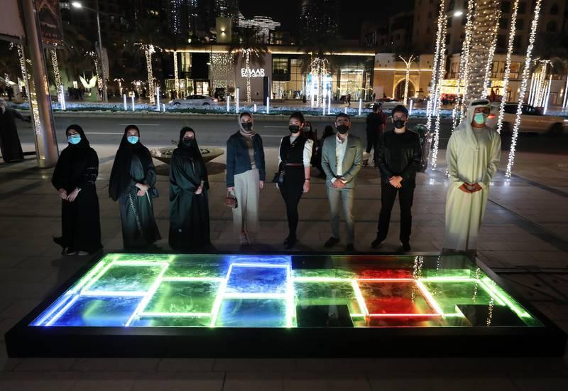Dubai, United Arab Emirates - Reporter: N/A. News. Art. The artists with a representative from Dubai culture. Al Hai, a series of enthralling light installations adorning Downtown Dubai Boulevard. This piece is called Al Saha. Dubai. Thursday, January 5th, 2021. Chris Whiteoak / The National