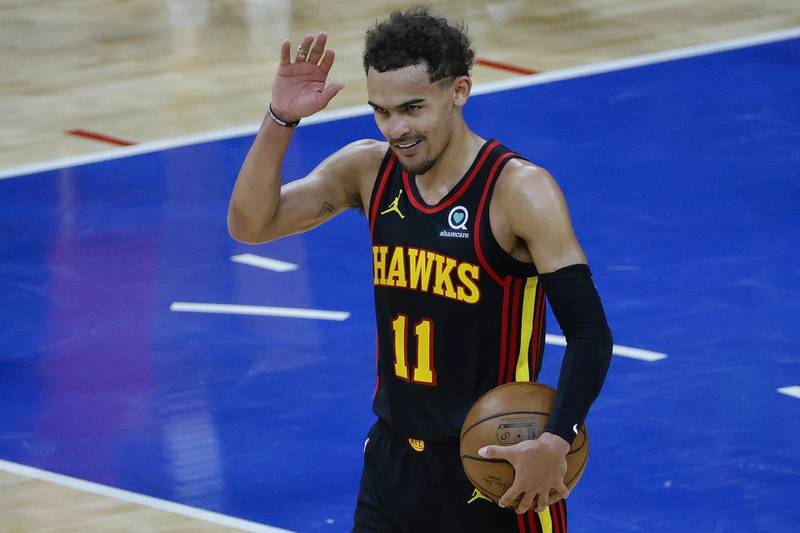 PHILADELPHIA, PENNSYLVANIA - JUNE 20: Trae Young #11 of the Atlanta Hawks celebrates after defeating the Philadelphia 76ers during Game Seven of the Eastern Conference Semifinals at Wells Fargo Center on June 20, 2021 in Philadelphia, Pennsylvania. NOTE TO USER: User expressly acknowledges and agrees that, by downloading and or using this photograph, User is consenting to the terms and conditions of the Getty Images License Agreement.   Tim Nwachukwu/Getty Images/AFP == FOR NEWSPAPERS, INTERNET, TELCOS & TELEVISION USE ONLY ==