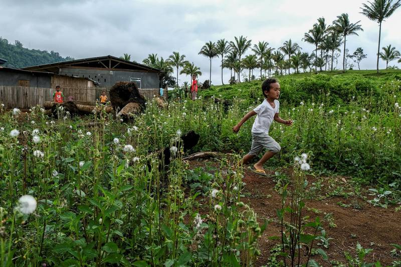 Lanao del Sur, Philippines - Displaced children play by the open fields near the Sagunsungan temporary shelter over two years since the siege of the capital, Marawi.   Photo by Veejay Villafranca/MSF