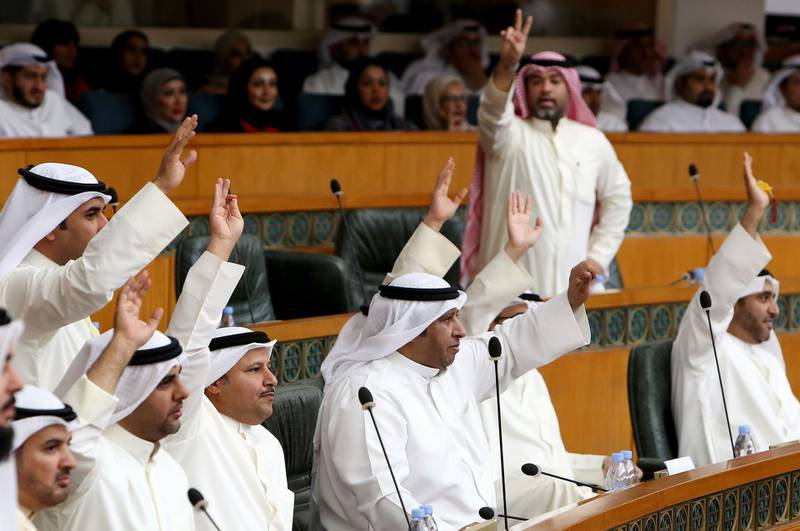 Kuwaiti MPs react during a parliament session at Kuwait's National Assembly in Kuwait City on March 6, 2018. / AFP PHOTO / YASSER AL-ZAYYAT