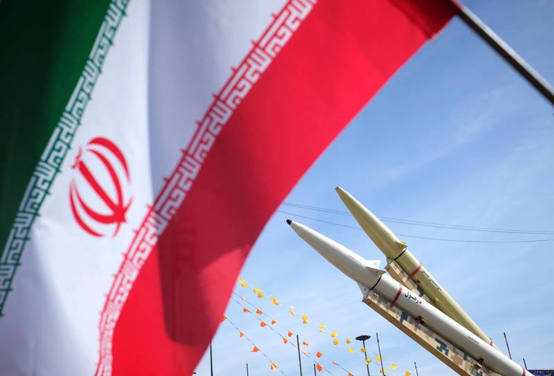 Iran-made, Dezful medium range ballistic missile (Bottom) and Zolfaghar road-mobile single-stage solid-propelled liquid fueled missile are seen next to an Iran flag in the Azadi (Freedom) square during a rally to commemorate the 42nd Victory anniversary of the Islamic Revolution, that held with motorcycles amid the new coronavirus disease (COVID-19) outbreak in Iran, in Tehran on February 10, 2021, on February 10, 2021.  (Photo by Morteza Nikoubazl/NurPhoto via Getty Images)