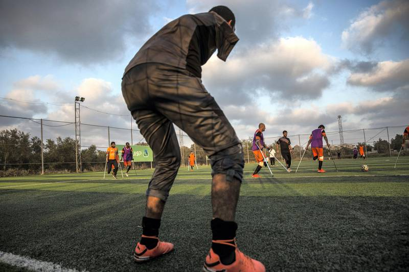 Palestinian goal keeper Islam Amoun is seen with other players during a practice held in Deir Al Balah in central Gaza on July 15,2018.(Photo by Heidi Levine for The National).