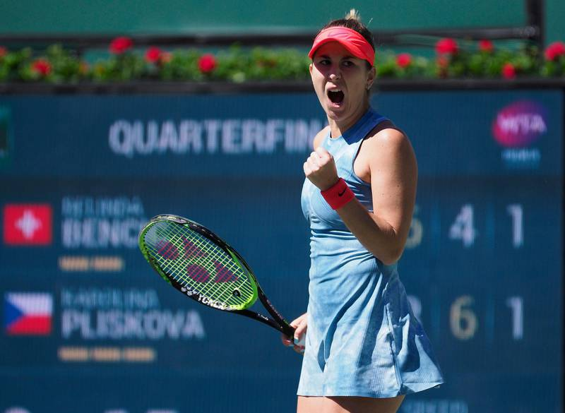 epa07437707 Belinda Bencic of Switzerland reacts after a point against Karolina Pliskova of the Czech Republic  during the BNP Paribas Open tennis tournament at the Indian Wells Tennis Garden in Indian Wells, California, USA, 14 March 2019. The men's and women's final will be played, 17 March 2019.  EPA/JOHN G. MABANGLO