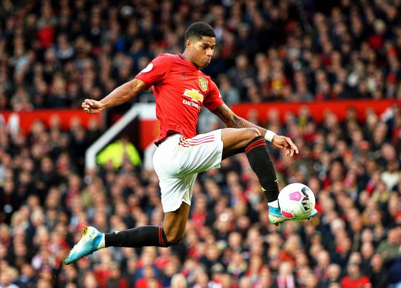epa07937076 Manchester United's Marcus Rashford scores the 1-0 lead during the English Premier League soccer match between Manchester United and Liverpool FC at Old Trafford in Manchester, Britain, 20 October 2019.  EPA/PETER POWELL EDITORIAL USE ONLY.  No use with unauthorized audio, video, data, fixture lists, club/league logos or 'live' services. Online in-match use limited to 120 images, no video emulation. No use in betting, games or single club/league/player publications.