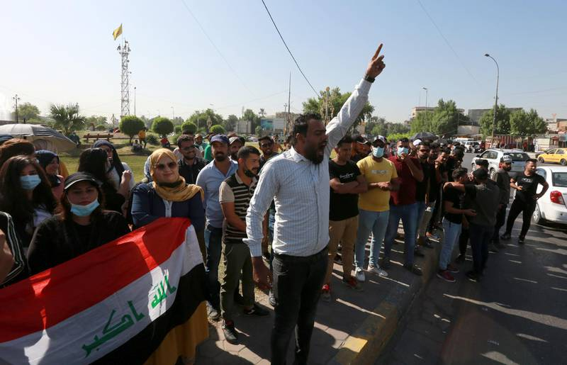 epa08762554 Iraqi unemployed graduates chant slogans during a demonstration near the green zone in central Baghdad, Iraq, 21 October 2020. Dozens of Iraqi graduates were wounded when Iraqi anti-riot police forces broke up their open sit-in front of the gates of green zone, which houses the headquarters of Iraqi government in central Baghdad.  EPA-EFE/AHMED JALIL *** Local Caption *** 56438579
