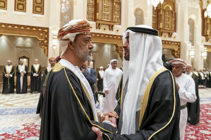 MUSCAT, OMAN - January 12, 2020: HH Sheikh Mohamed bin Zayed Al Nahyan, Crown Prince of Abu Dhabi and Deputy Supreme Commander of the UAE Armed Forces (R), offers condolences to HM Sayyid Haitham Bin Tariq Al Said, Sultan of Oman (L), on the passing of HM Qaboos bin Saeed, Sultan of Oman, at Al Alam Palace.  ( Mohamed Al Hammadi / Ministry of Presidential Affairs ) ---