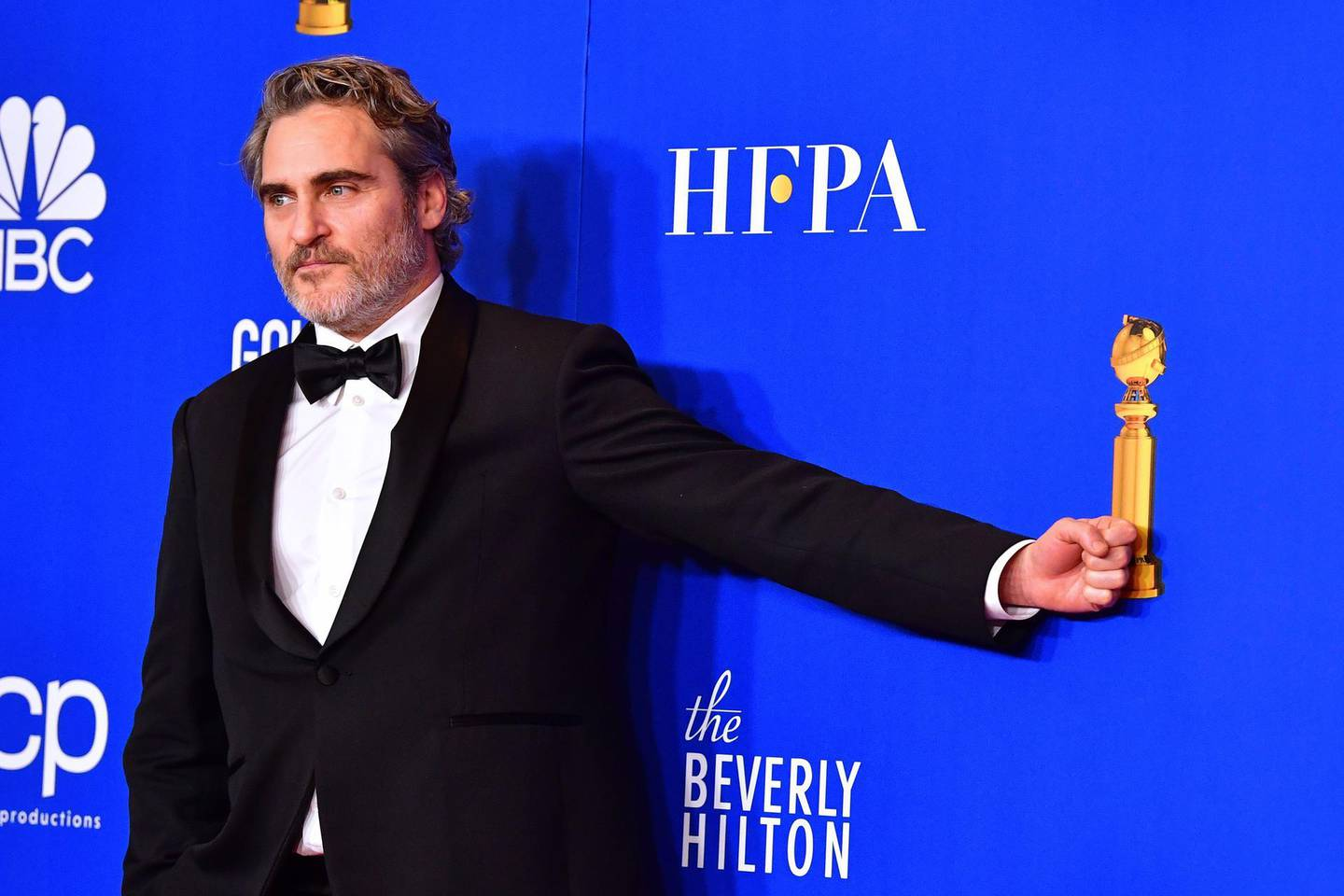 US actor Joaquin Phoenix poses in the press room after winning the award for Best Performance by an Actor in a Motion Picture - Drama during the 77th annual Golden Globe Awards on January 5, 2020, at The Beverly Hilton hotel in Beverly Hills, California. / AFP / FREDERIC J. BROWN