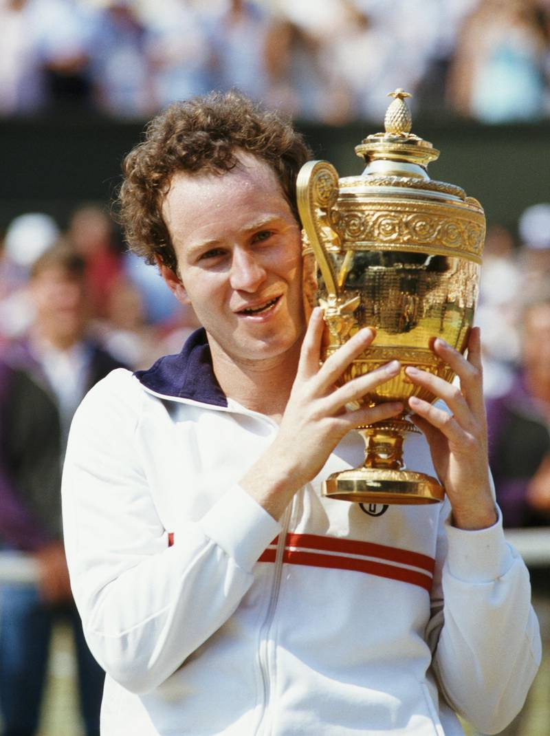 John McEnroe of the United States holds aloft the championship trophy after defeating Jimmy Connors to win the Men's Singles Final match at the Wimbledon Lawn Tennis Championship on 8 July 1984 at the All England Lawn Tennis and Croquet Club in Wimbledon in London, England. (Photo byTrevor Jones/Getty Images)